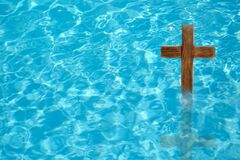 Free Wooden Cross In Water For Religious Ritual Known As Baptism Royalty Free Stock Image - 202412726