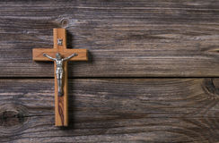 Wooden cross with jesus on a background for a obituary notice. Royalty Free Stock Photo