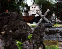Wooden cross leaning on rock. Old cross serves as place of worship.nCity of São Paulo / State of São Paulo / Brazil, July 05, 2019 stock images