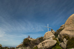 Wooden cross and memorial on rock in Corsica Royalty Free Stock Images