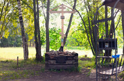 A wooden cross of the memory of Grigory Rasputin in the Alexander Park of Pushkin, St. Petersburg. ST. Petersburg, Russia - August 19, 2017: A wooden cross in Royalty Free Stock Image