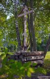 The wooden cross of the memory of Grigory Rasputin. St. Petersburg, Russia - August 19, 2017: Memorial cross with icons, established in 2003. The text on the Stock Images