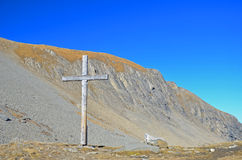 Wooden Cross on a Mountain Pass Royalty Free Stock Photo
