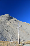 Wooden Cross on a mountain pass Stock Photography