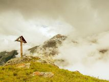 Wooden cross at a mountain peak in the alp.  Royalty Free Stock Image