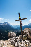 Wooden cross on mountain's top. Wooden cross standing on the of a mountain, Col Rosa, Cortina'dAmpezzo Royalty Free Stock Image