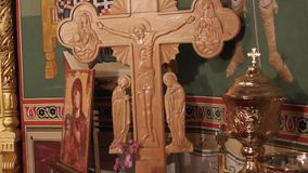 Wooden cross near the altar. In an orthodox church stock video footage