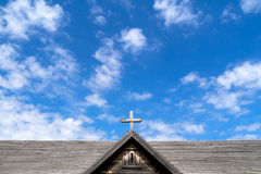 Wooden Cross on Old Church against blue sky Royalty Free Stock Photos