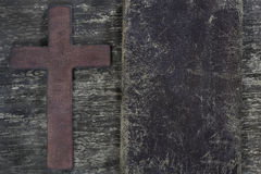 Wooden cross and old leather Stock Photo