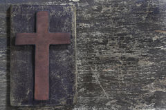 Wooden cross and old leather Royalty Free Stock Image