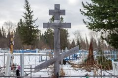 Wooden cross in the old village cemetery. Wooden cross in the old village cemetery of the village Belogorsk, in the winter. Tisulsky district, Kemerovo region Royalty Free Stock Image