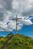 Wooden cross and partly cloudy sky. Wooden cross against partly cloudy sky Stock Image