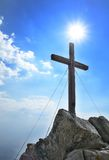Wooden cross on peak Royalty Free Stock Photos
