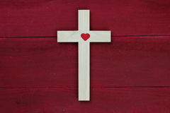 Wooden cross with red heart on antique red wood background Stock Photo
