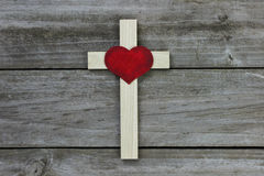 Wooden cross with red heart on rugged wood background Stock Photography