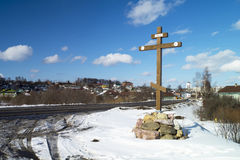 Wooden cross beside roads. On background blue sky at the beginning initially city Mstera,Russia Royalty Free Stock Photos