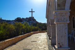 Wooden cross on a rock near the church of St. Epiphany. Cyprus. Ayia Napa.  Royalty Free Stock Image