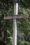The Wooden Cross. A wooden cross set back in the woods Royalty Free Stock Photo