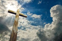 Cross against the sky. Happy Easter. Christian symbol. Wooden cross on sky background with clouds, 3D illustration Happy Easter. Christian symbol Royalty Free Stock Photo