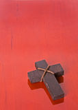 Wooden cross on a table, lower right corner Royalty Free Stock Photos