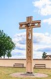 Wooden cross in the territory of the church of the Holy Trinity. Liskiava Stock Photos