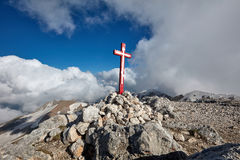 Wooden cross on top of the mountain. Mountain landscape Stock Images