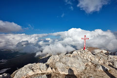 Wooden cross on top of the mountain. Mountain landscape Stock Image