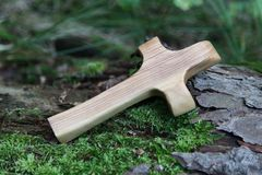 Wooden cross with tree on a green natural background Stock Image