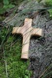 Wooden cross with tree on a green natural background Royalty Free Stock Image