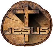 Wooden Cross on Tree Trunk Royalty Free Stock Image