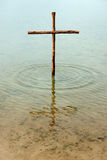 Wooden cross in the water Royalty Free Stock Images