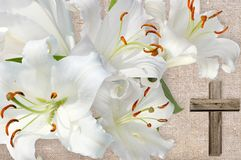 Wooden cross and white lily. On background fabrics gray Royalty Free Stock Photography