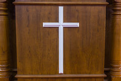 Wooden cross on wood background Stock Photography