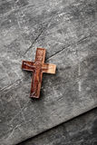 Wooden cross on a wooden background Stock Image