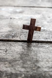 Wooden cross on a wooden background Stock Images