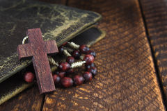 Wooden cross on  wooden board Stock Photo