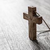 Wooden cross on a wooden surface Stock Photos