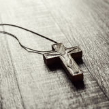 Wooden cross on a wooden surface Stock Photography