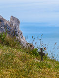 Wooden crosses on the edge of white chalk cliffs royalty free stock photos