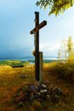 Wooden crosses sit upon a hill in the sunset with Royalty Free Stock Photo