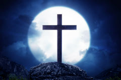 Wooden crosses standing on rock hill with moonlight Stock Image