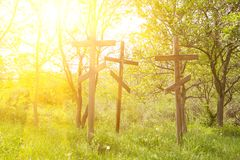 Wooden crosses in sunlight. Three wooden crosses on the hill Royalty Free Stock Photography