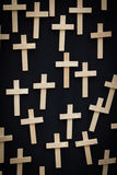 Wooden crosses suspended on a black canvas Royalty Free Stock Photos