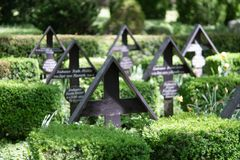 Wooden crosses in a woodland cemetery royalty free stock photo