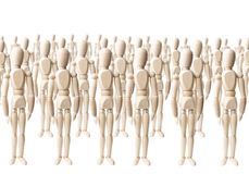 Wooden Crowd. Large group of wooden dummies forming a crowd on white royalty free stock photos