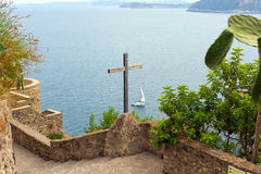 Wooden crucifix in the Aragonese Castle Stock Images
