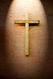 Wooden crucifix on the brick wall Royalty Free Stock Photo