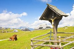 Wooden Crucifix in the famous place called `Velika Planina`; in Slovenian it means `great plateau` and it is one of the most impor Stock Images