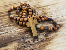 Wooden crucifix with rosary Stock Photography