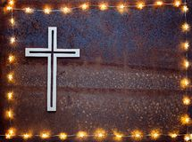 Wooden crucifix on rusty iron Royalty Free Stock Image